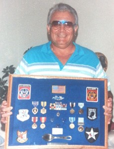 Moreno with a shadow box of duplicate medals presented to him by his family after his originals were stolen.
